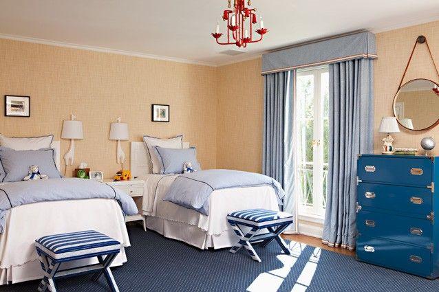 Boys/guest bedroom - grasscloth, blue dresser, hanging mirror, red chandelier, x-benches