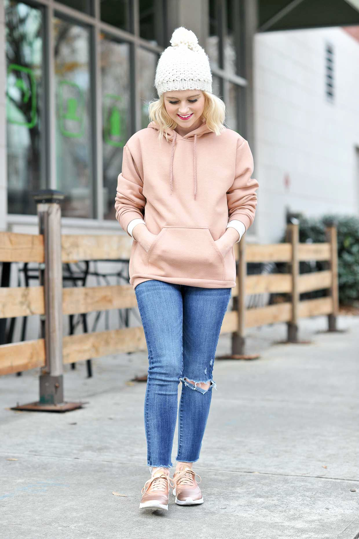 0b087d58d Nike Metallic Air Max Thea Rose Gold Sneakers - Poor Little It Girl. Blush  hoodie+ripped jeans+rose gold sneakers+white pom-pom knit beanie.