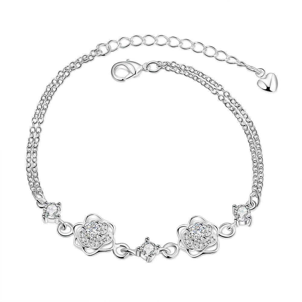 Нежна гривна за глезен с флорални мотиви, украсена с блестящи бели циркониеви кристали и сребърно покритие. Чудесно лятно бижу за повече повече приятни емоции. Код: NB146.