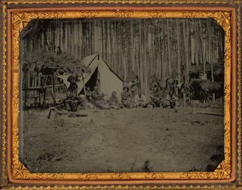 Confederate Militia Camp in Georgia. Men of Georgia Militia cavalry unit relaxing in front of their tent. | collections.mohistory.org