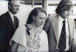 Kozak escorts British doctor Sheila Cassidy to the plane taking her out of Chile, in 1975.