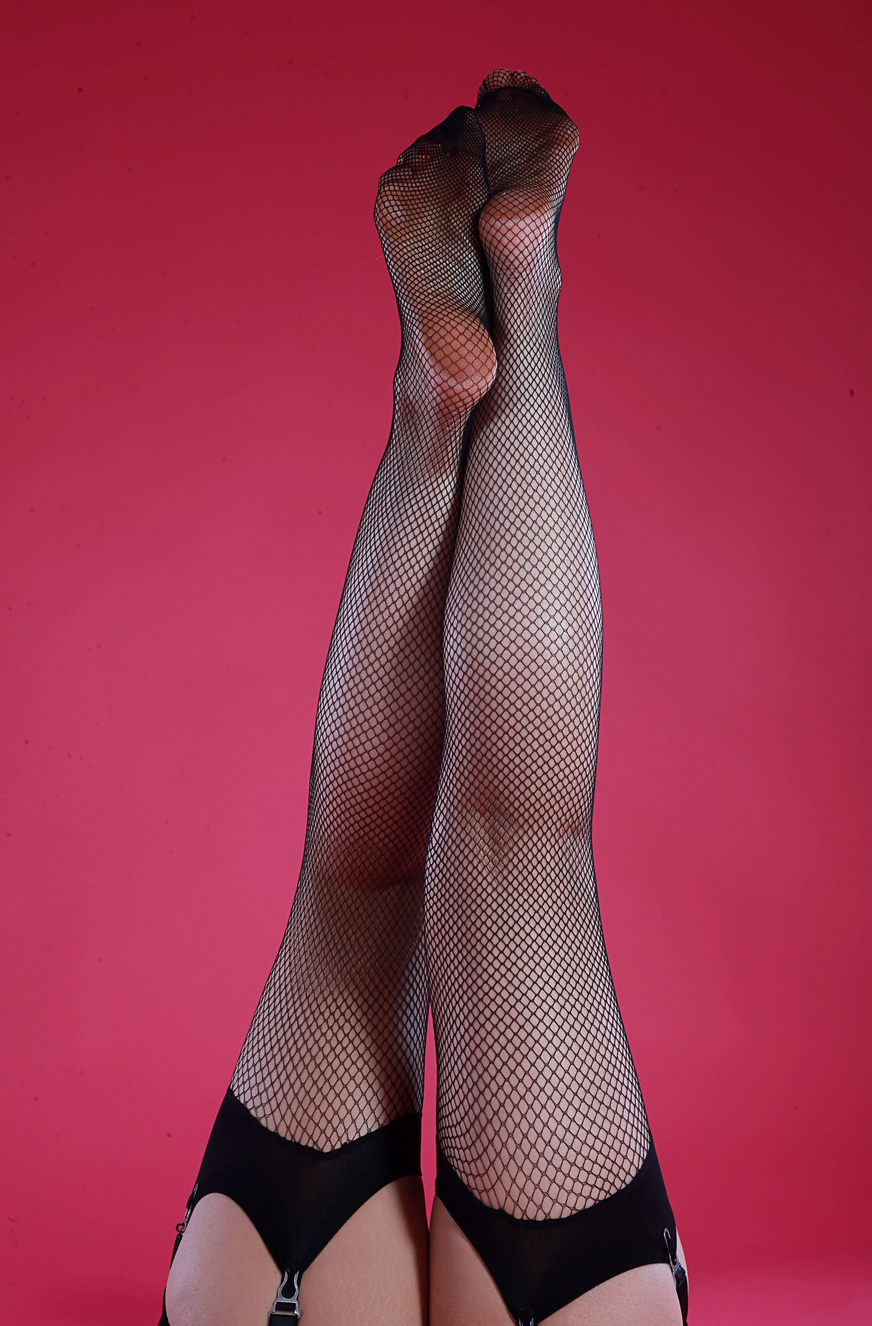 12b5c7db9 Black fishnet stockings. High quality nylons and a staple vintage item for  all pin up wardrobes. Wear with a girdle