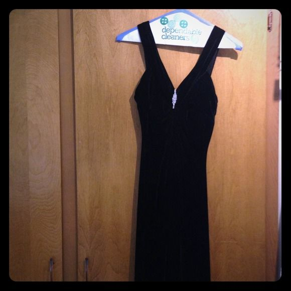 Gorgeous long black dress/gown  Gorgeous dres! Has a velour feel to it. It's a polyester spandex blend. Has. Sexy slit up the left leg and cute bling on the top. Very pretty on! I only wore it once then had it dry cleaned. In excellent condition! masquerade Dresses
