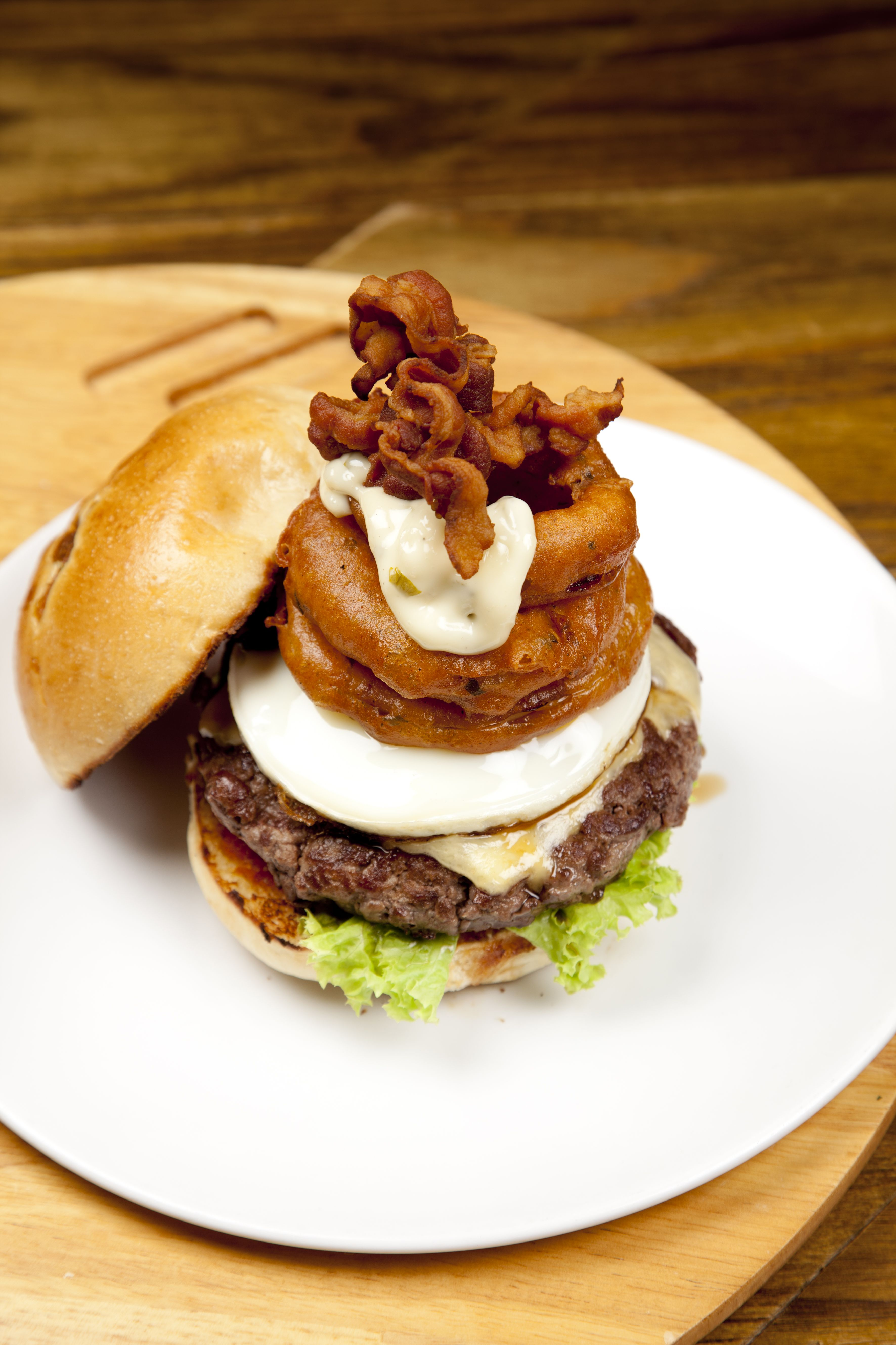 The Works Burger Made With 100 Grass Fed Beef Patty Sunny Side Up Egg Cheese Onion Rings Bacon Thehandburger Thesoupspoonuni Food Burger Grass Fed Beef