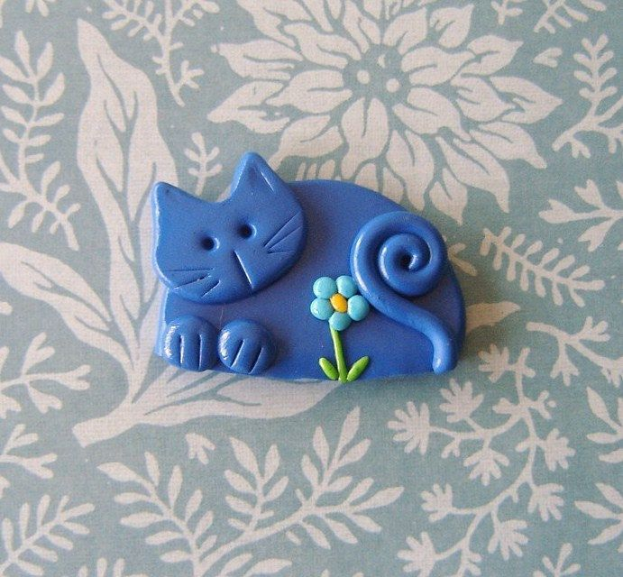 Polymer Clay Blue Cat with Turquoise Flower pin or magnet. $10.00, via Etsy.