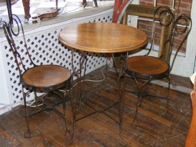 This is a very lovely ice cream parlor set of 2 chairs and a table. - Old Antique 3 Pc Ice Cream Parlor Table & 2 Chair Set Wood & Copper