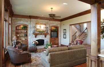 Like the stained bead board on the back of the bookcases.  Think that would look & sort of play off the paneled ceiling.  Probably would not even need to be built-in/custom made.  Could probably be a DIY project with a/some nice piece(s) of furniture .... repurposed .. or not.