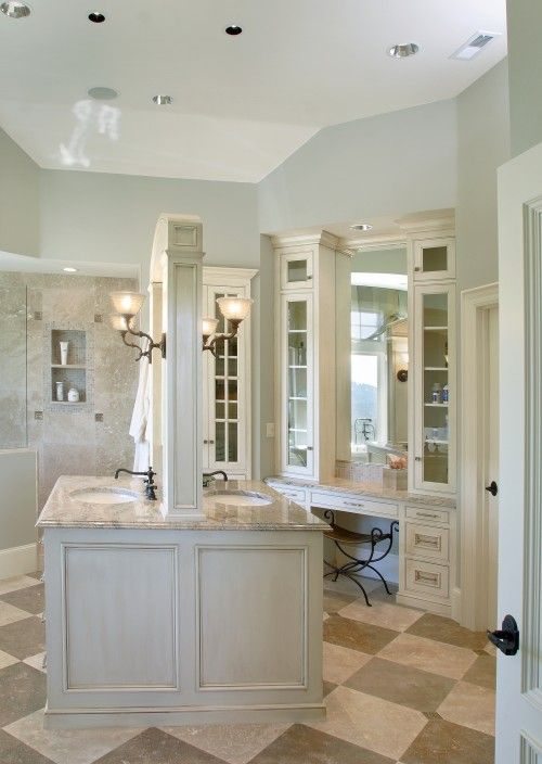 In This Bathroom Design By Barclay Interiors A Back To Back Vanity Creates Privacy And Utilizes Some Of T Traditional Bathroom Bathroom Island Bathroom Design