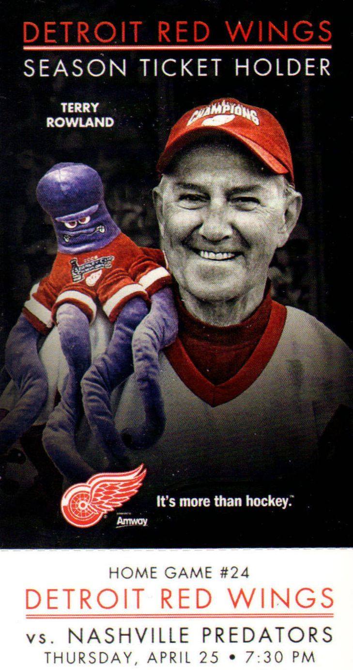 a fan is featured on this ticket as a season ticket holder hockey