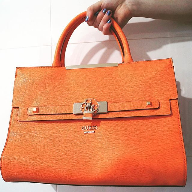 c38ba530890 I cannot get over the perfect orange hue of this  guess handbag, especially  to