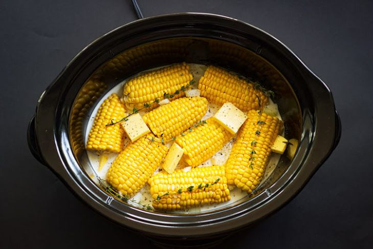 Slow-Cooker Corn on the Cob Recipe Side Dishes with coconut milk, onions, garlic, pepper, salt, butter, fresh thyme, ear of corn
