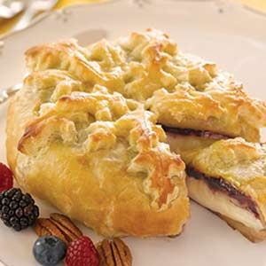 Triple Berry Baked Brie Recipe  Love the decorative top made out of the puff pastry extras.
