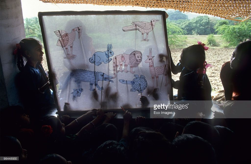 Stock Photo : EDUCATION, INDIA. Andra Pradesh, Rishi Valley. Centre for New Education. - New approaches to education in India. Children learn through shadow theatre.