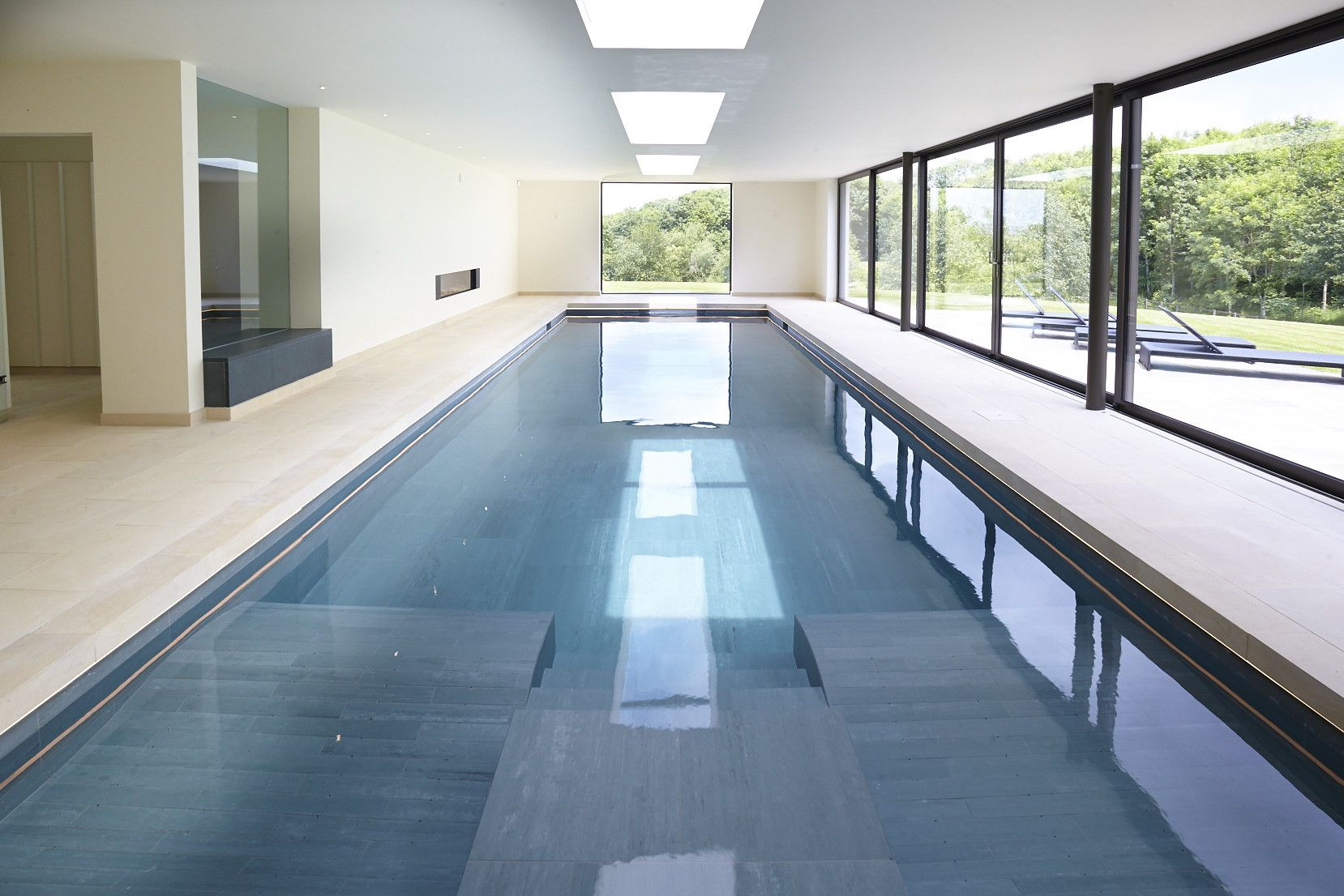 Indoor swimming pool with counter current unit for swim ...
