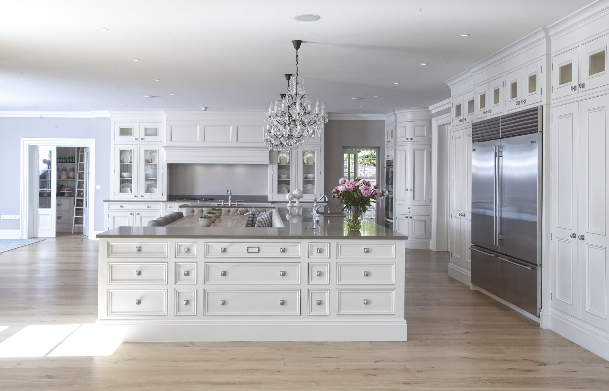 large island with built in banquette coastal hideaway sandbanks hayburn co kitchen on u kitchen with island id=82275