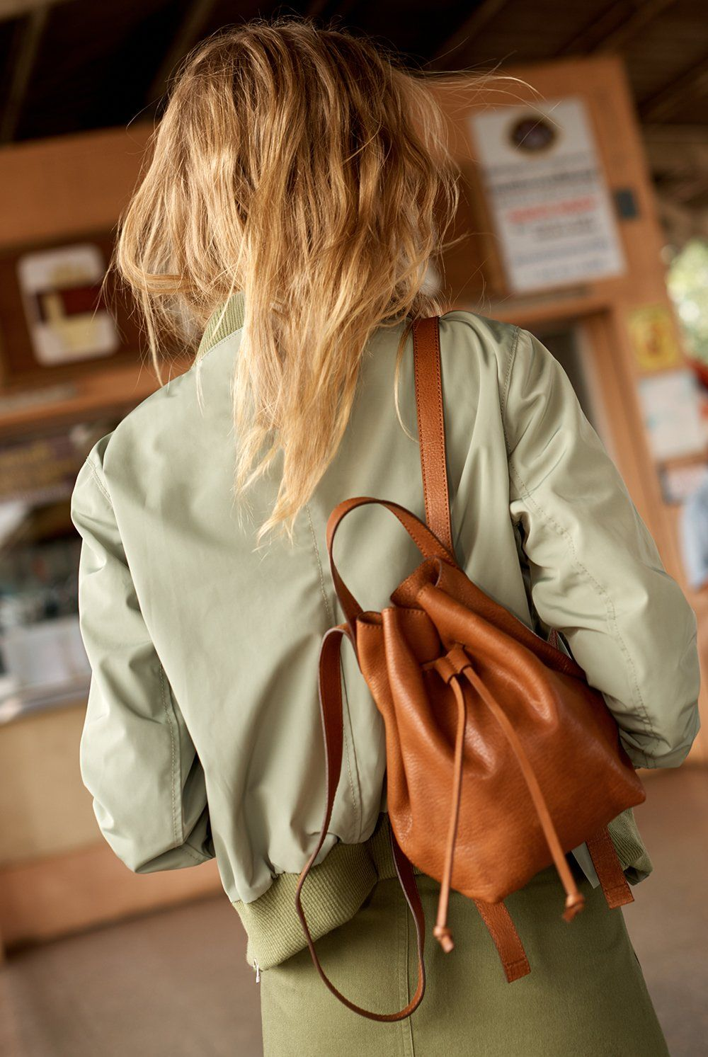 fe959a4fd38c madewell somerset mini backpack worn with the side-zip bomber jacket ...