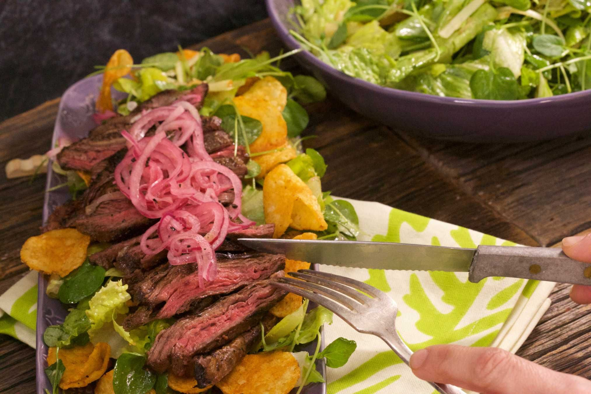 Sliced Steak Salad with Chipotle Vinaigrette and BBQ Chips.