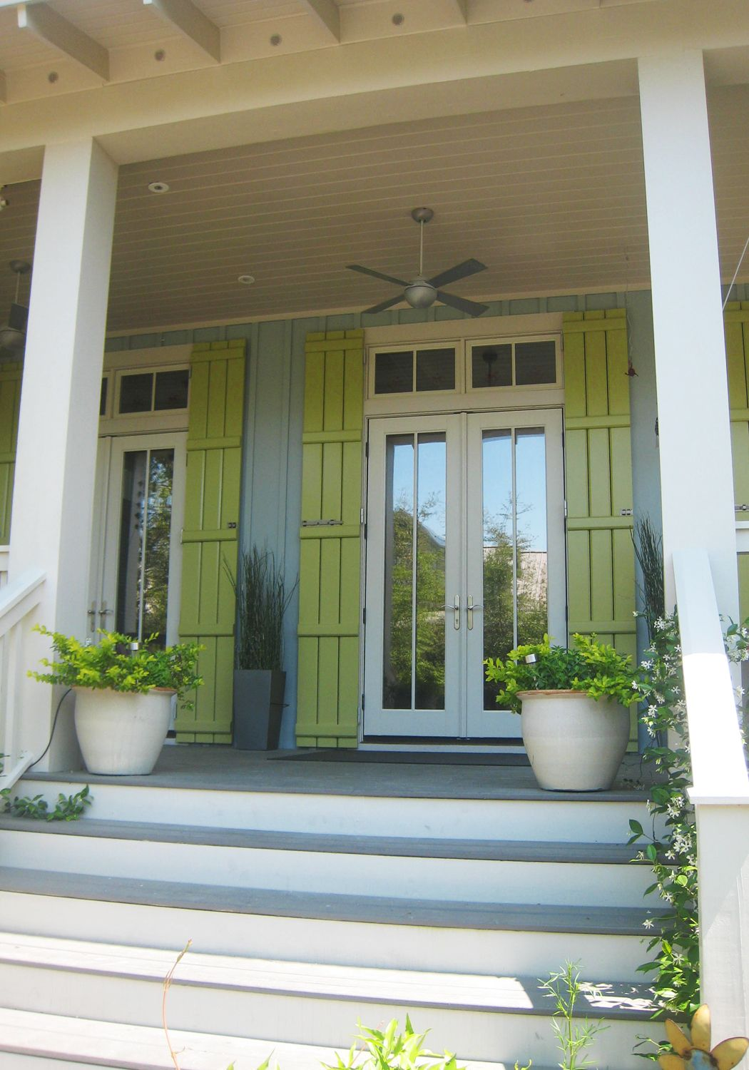 Painted front doors and shutters - Cottages With Green Siding Blue Gray Vertical Siding Paired With A Citrus Green Shutter