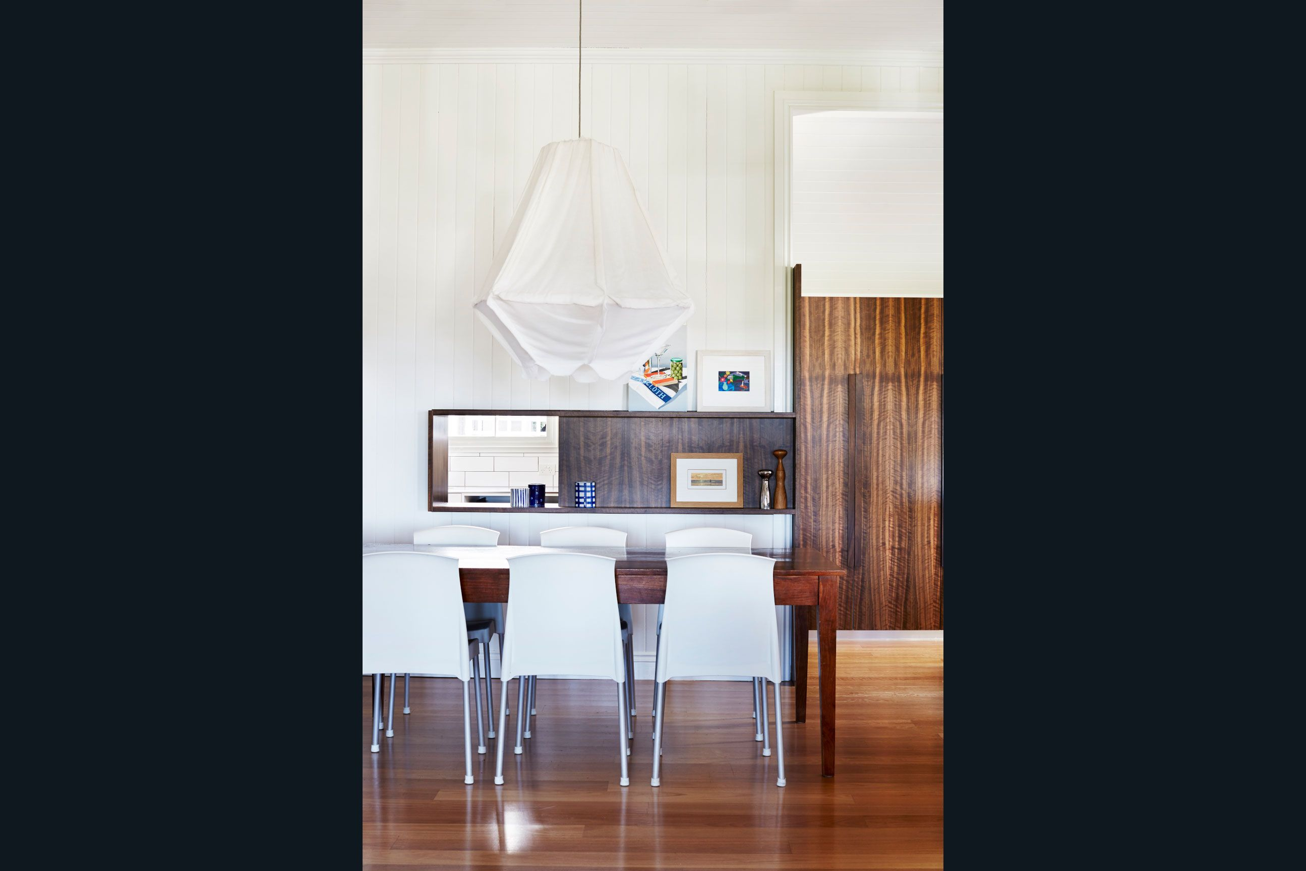 Contemporary dining room with custom timber joinery and pass thru.  White fabric feature light pendant. With James Davidson Architect. Interiors by TWOFOLD STUDIO.
