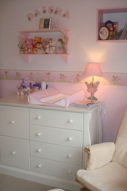 Fairy Nursery Room Painted In 2 Tone Pink And Compliment With A Beautiful Wall Border White Furniture