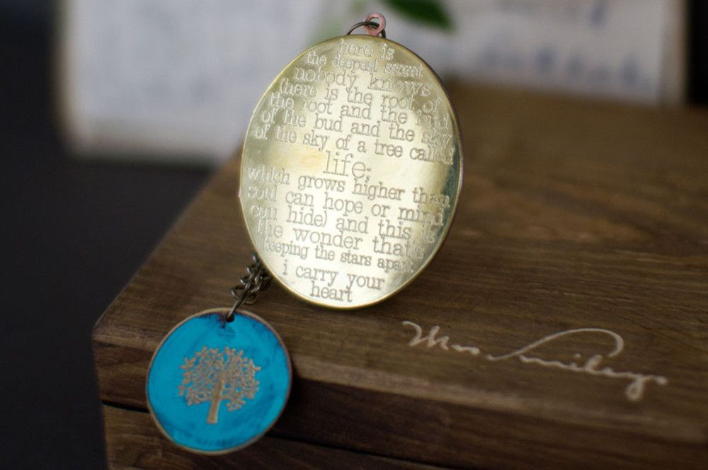 "i carry your heart    A very special piece featuring an engraving of the last stanza from e.e. cummings ""i carry your heart"". Matched with a patina blue finished tree charm and your choice of either a 60cm or 80cm chain."