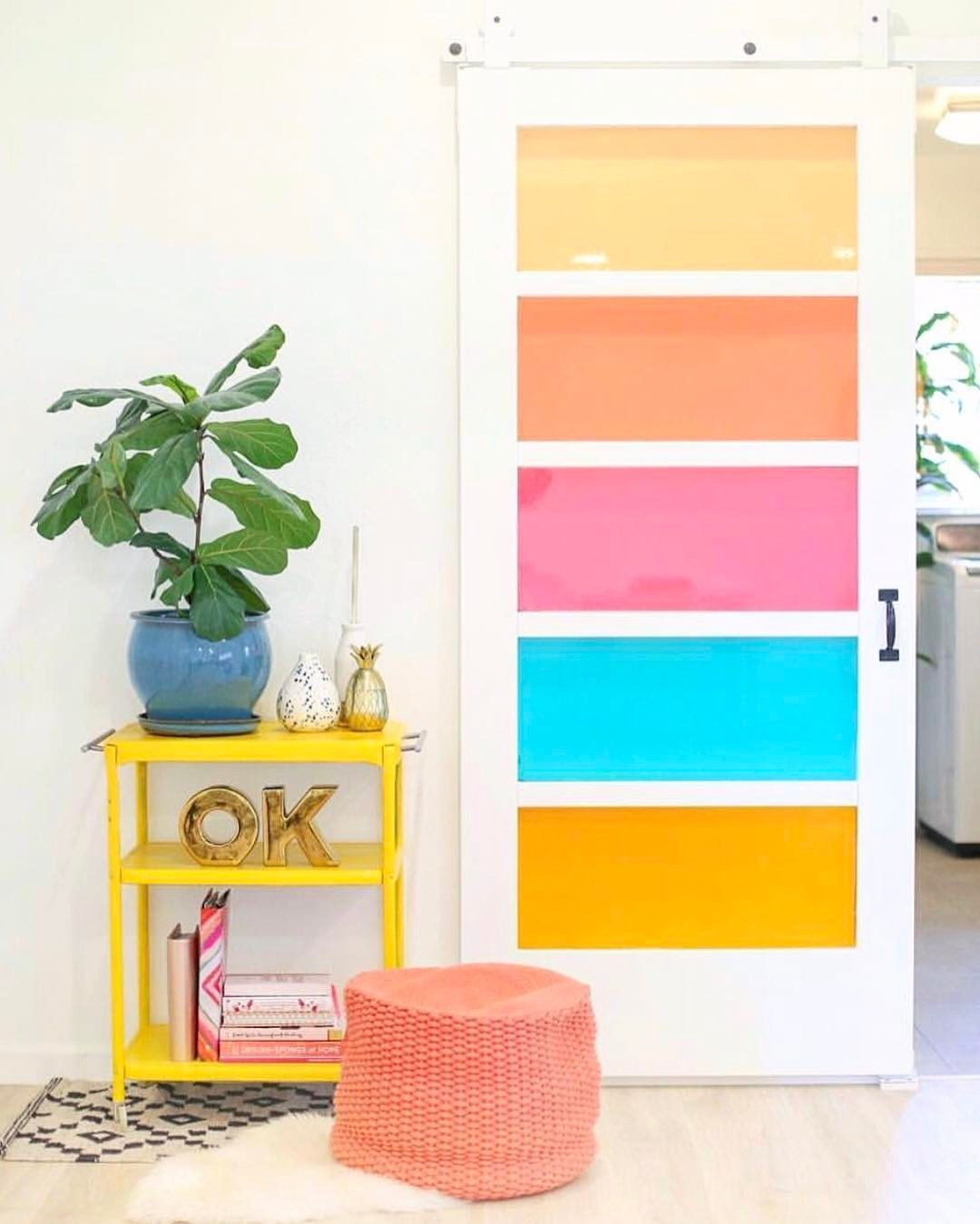 Love this view of our DIY faux stained glass barn door.because everything  looks prettier through rainbow colored glass!