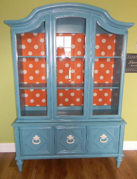 I love the look and color of this cabinet...just not the polka dot. Would pick a different fabric to cover back.
