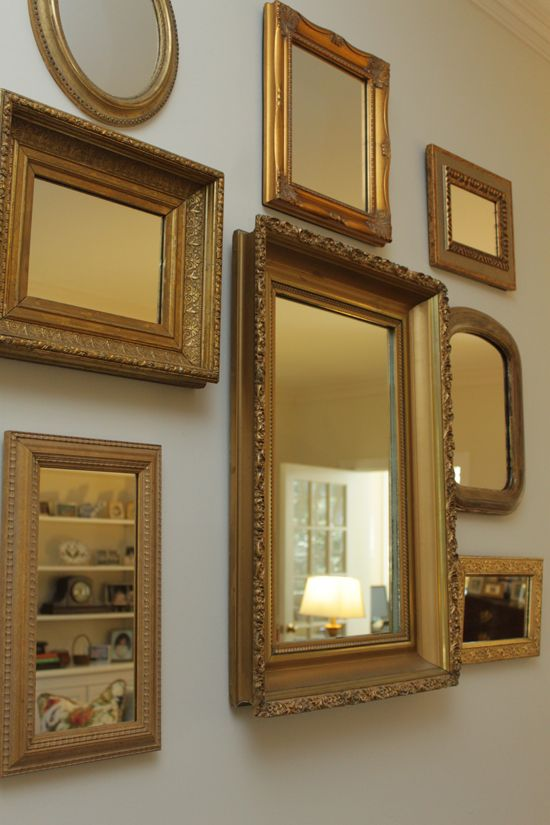 A Collection Of Varying Gold Framed Mirrors Makes A