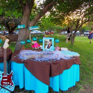 Grooms table outdoor country wedding-colors turquoise, chocolate & fuchsia.......theme was birds and guitars