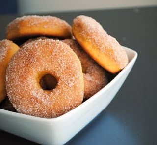 spiced sweet potato donuts. baked and tossed in cinnamon sugar. as healthy as a donut can get.