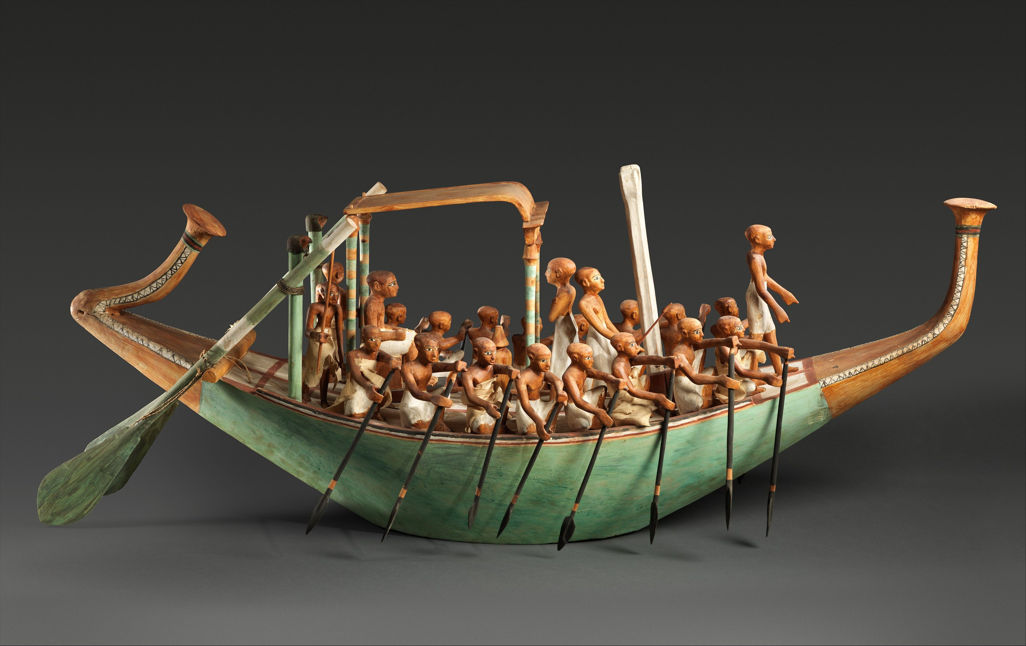 Works of Art at the MET <<>> Model Paddling Boat -Period: Middle Kingdom -Dynasty: Dynasty 12 -Reign: reign of Amenemhat I, early -Date: ca. 1981–1975 B.C. -Geography: From Egypt, Upper Egypt, Thebes, Southern Asasif, Tomb of Meketre (TT 280, MMA 1101), MMA excavations, 1920 -Medium: Wood, paint, plaster, linen twine and cloth -Credit Line: Rogers Fund and Edward S. Harkness Gift, 1920 -Elite Middle Kingdom tombs could contain model boats along with workshop models.