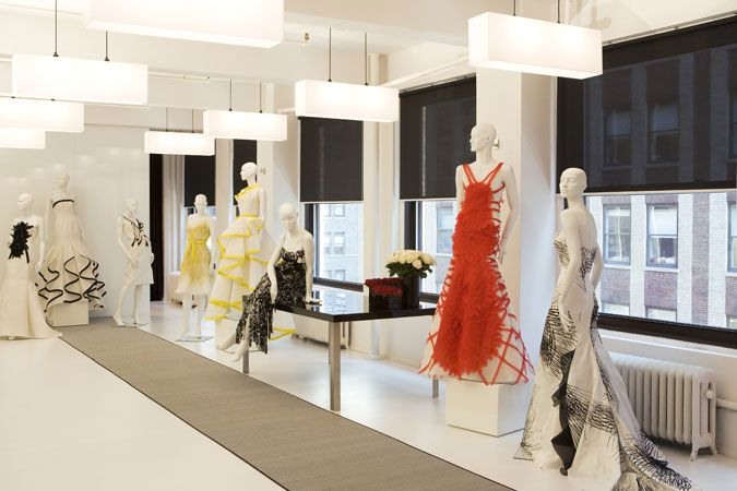 A nyc showroom for a high end fashion designer uses black and white to accent the designer for Fashion retail interior design