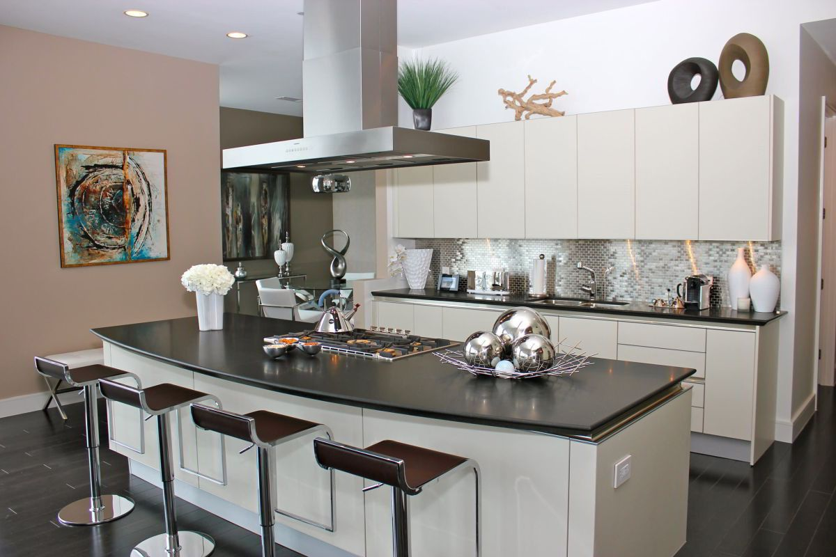 Kitchen island with stools completing open white cabinets montage