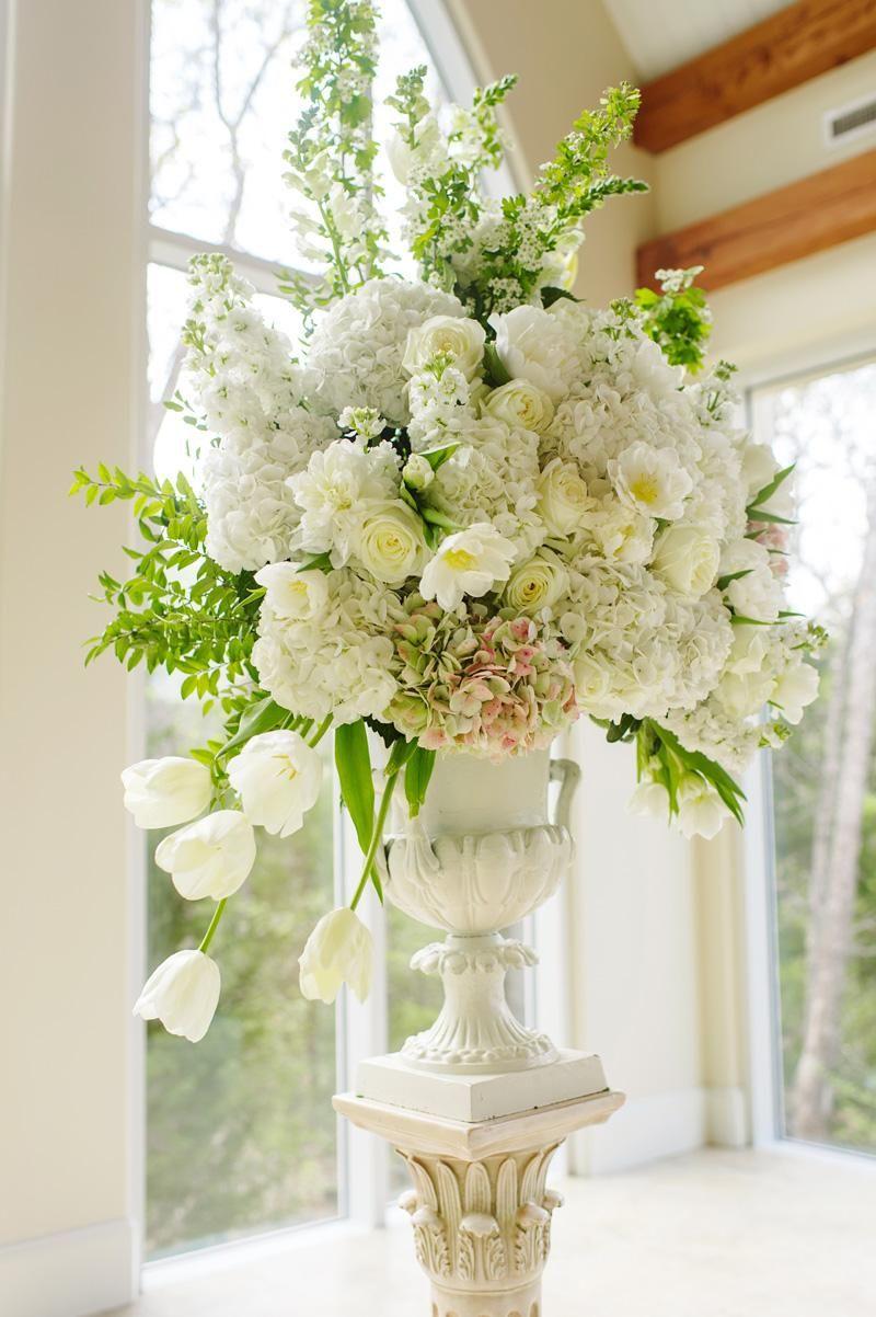 Lovely White Floral Arrangement Wedding By Dfw Events Photo By Celina Gomez Pho White Floral Arrangements White Flower Arrangements Large Floral Arrangements