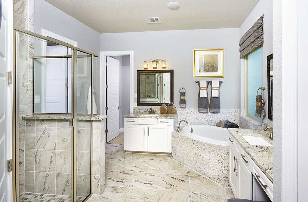 Gehan Homes Master Bathroom - Gold accents, white wood cabinets ...