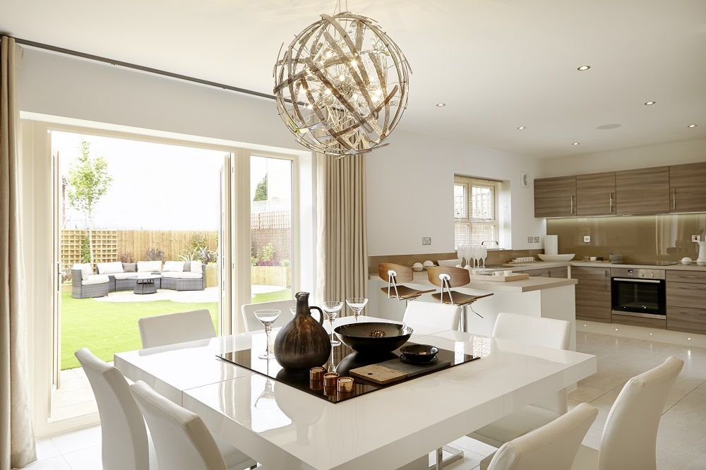 The open plan #kitchen, dining and family area at the back of the home is filled with light from the double French doors leading to the garden.