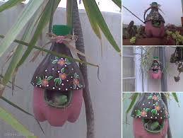 Resultado de imagen para casitas para pájaros con botellas de plástico recicladas