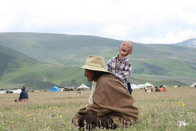 The Litang Horse Festival: Quite possibly the happiest little boy in Litang © Shaula Ponsen