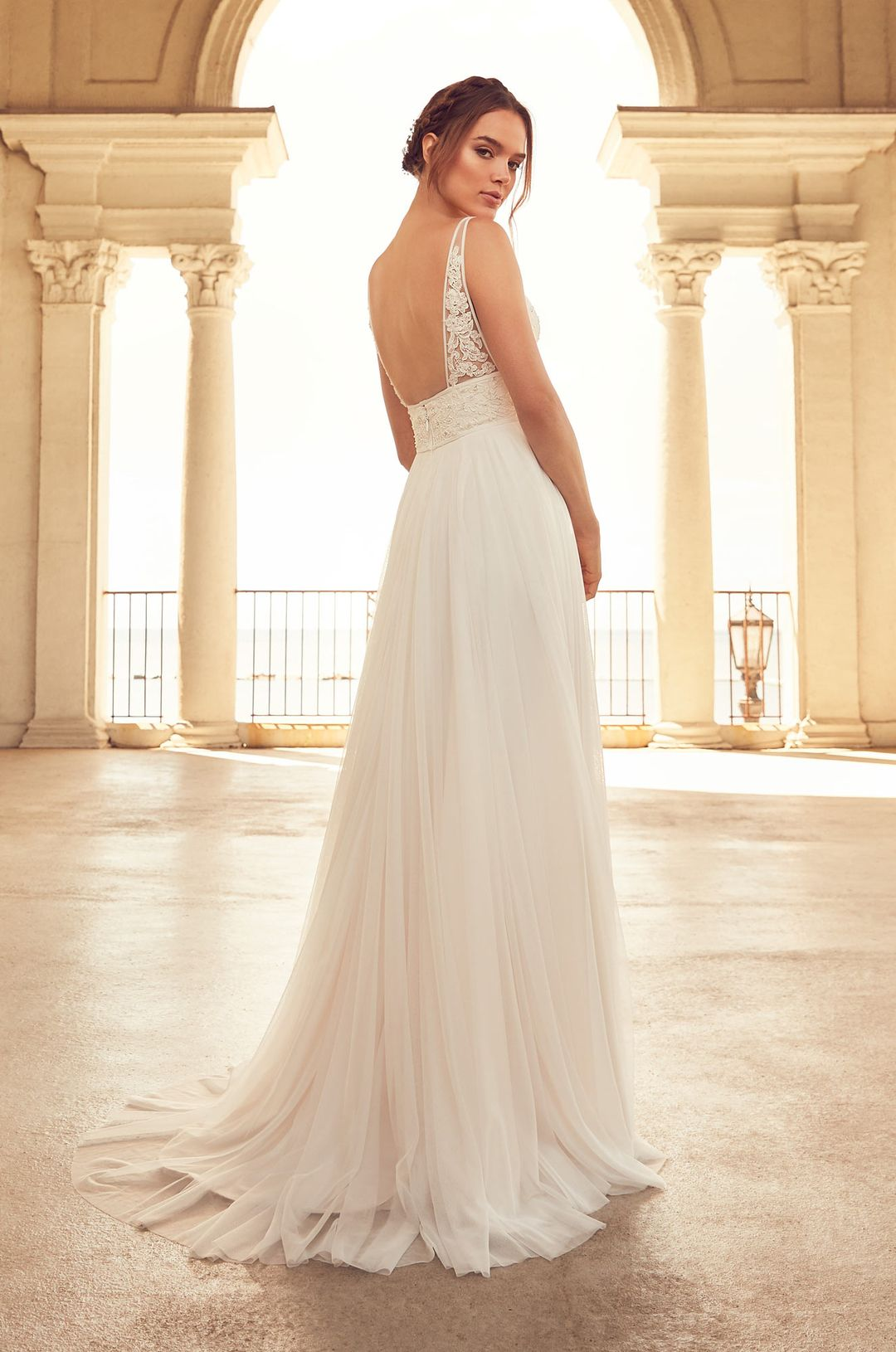 9202d76d9f1 Flowing Empire Wedding Dress - Style  4787 from Paloma Blanca. V-neckline  bodice with beaded lace appliqués along bodice. Full Mesh Tulle skirt.