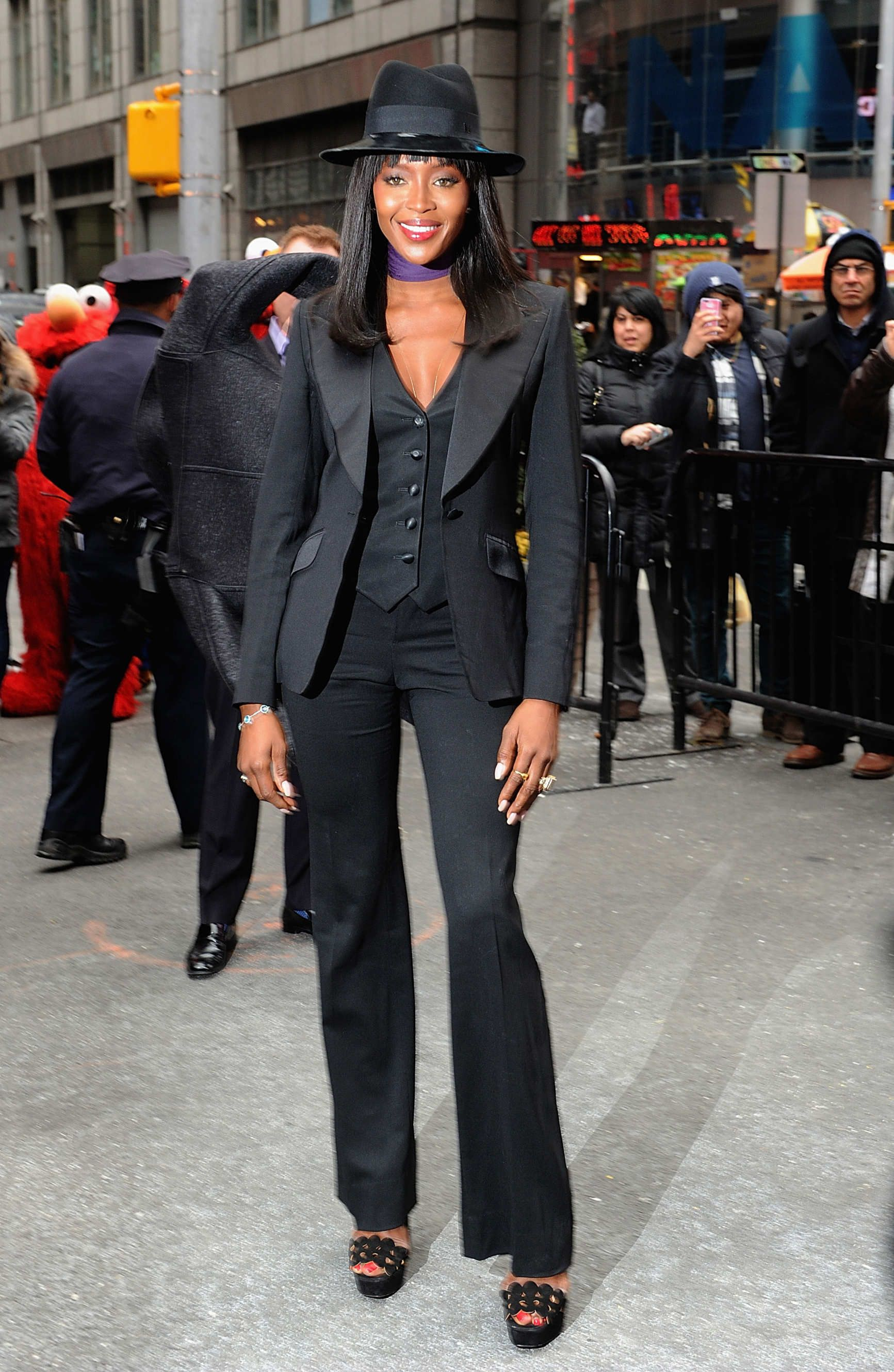 bcf7bc19a4f Le Smoking: classic and modern takes on Yves Saint Laurent's iconic ladies'  tuxedo. Naomi Campbell, 2014