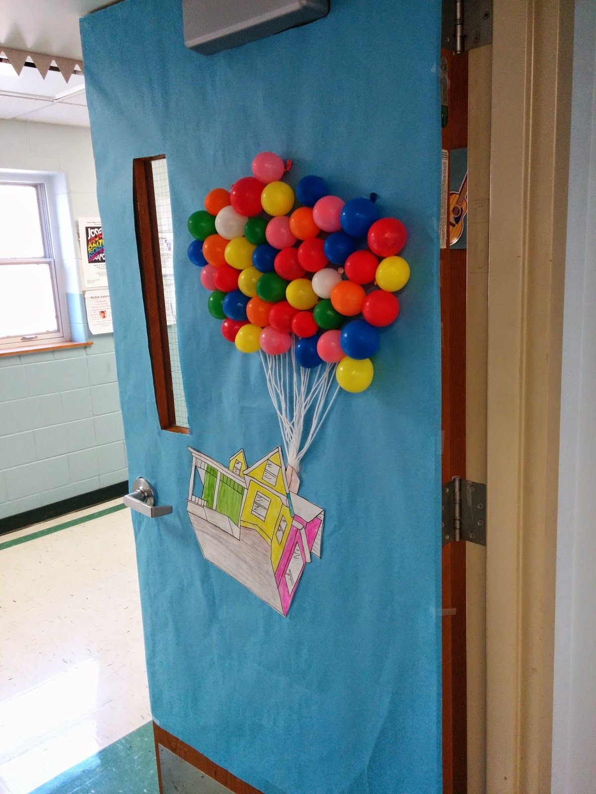 Classroom door decor for spring up disney pixar for Porte decorate scuola