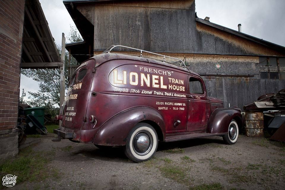 WWII Era Chevy Panel Truck With Roof Rack And Vintage Business Graphics
