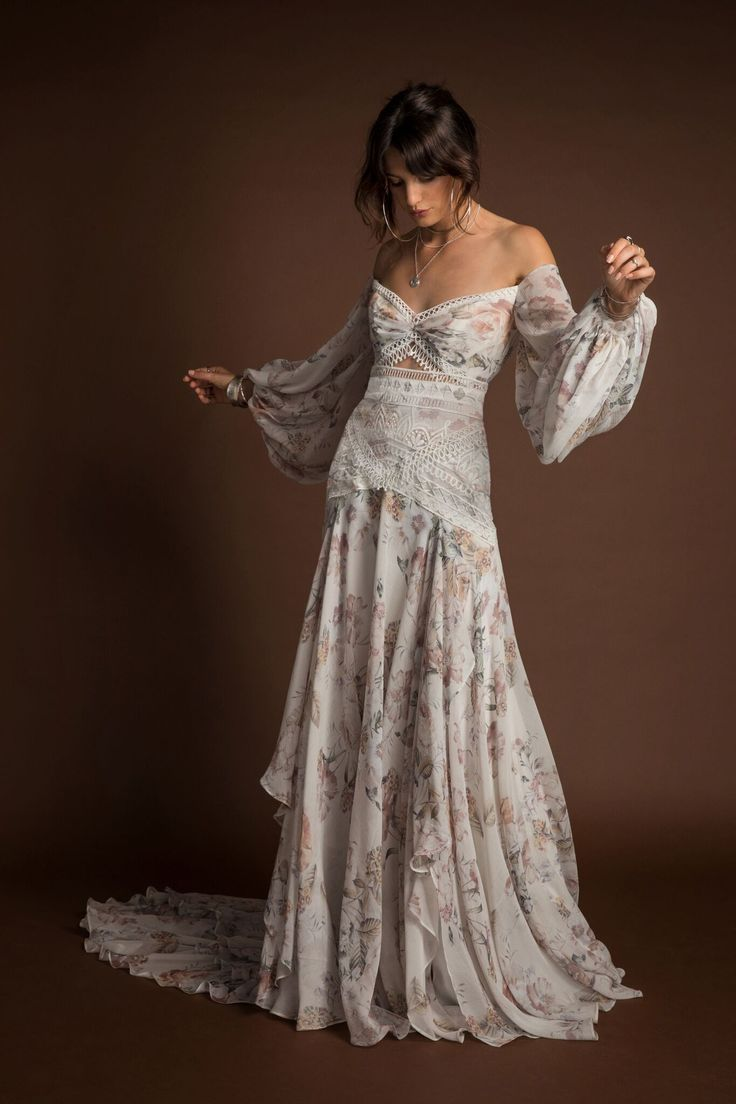 RUE DE SEINE'S NEWEST COLLECTION ~ THE WILD HEART COLLECTION   FIND OUT WHERE YOU CAN GET 10% OFF AT A&BE BRIDAL SHOP   Nahla Gown   An explosion of colour and texture is the ultimate floral bohemian fantasy.   Off the shoulder bodice with billowing sleev
