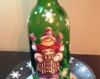 Hand painted and mixed media Snowman candle holder made from a recycled wine bottle and glass plate. It can be left out all winter.