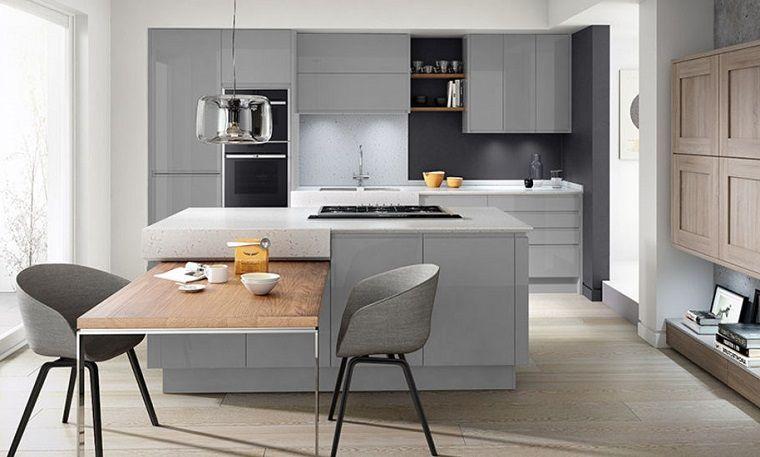 Cucine con isola centrale dal design moderno, tavolo in legno a ...