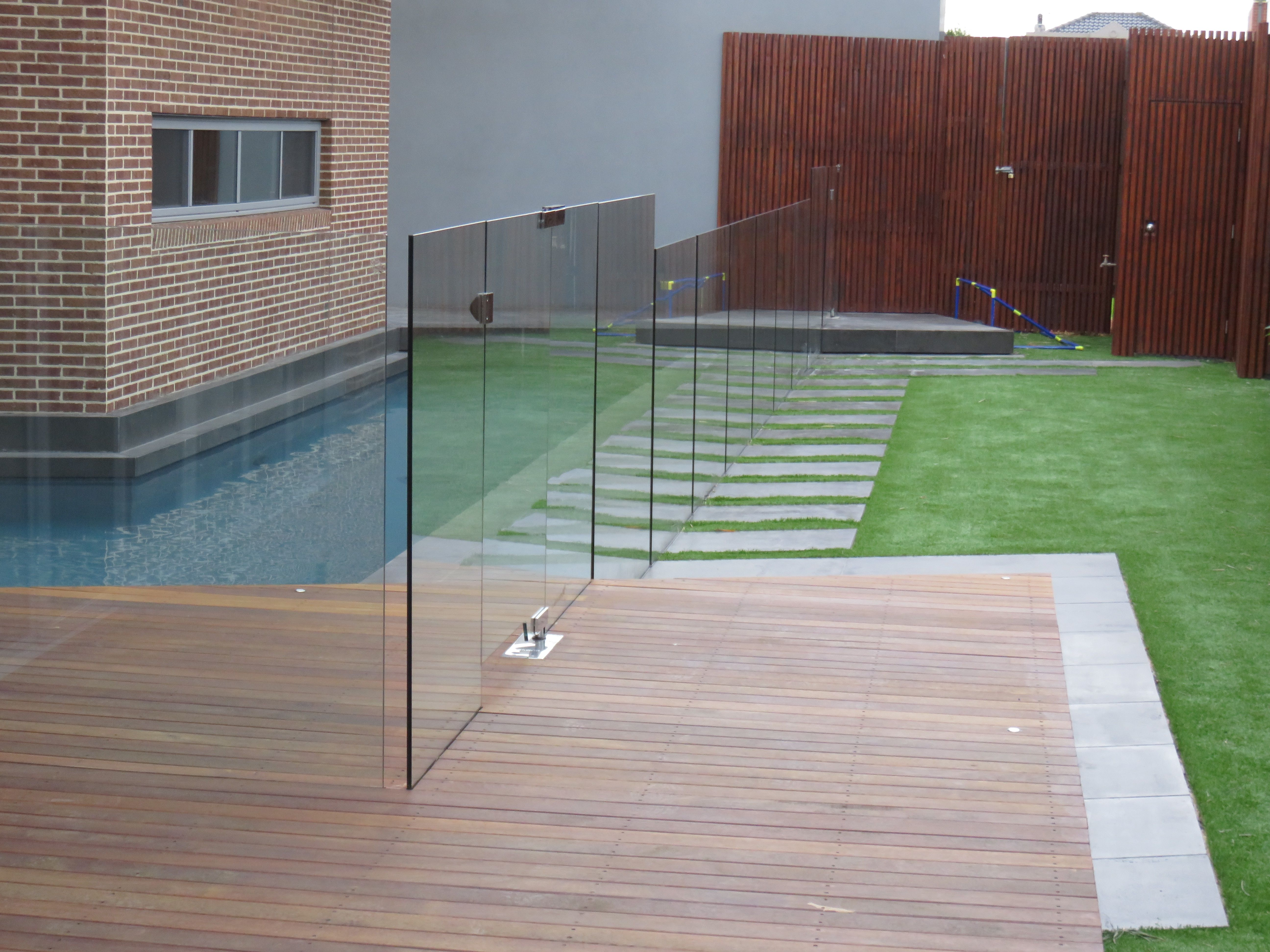 Glass Pool Fence Merbau Deck And Artificial Turf Backyard Landscaping Designs Glass Pool Fencing Landscape Projects