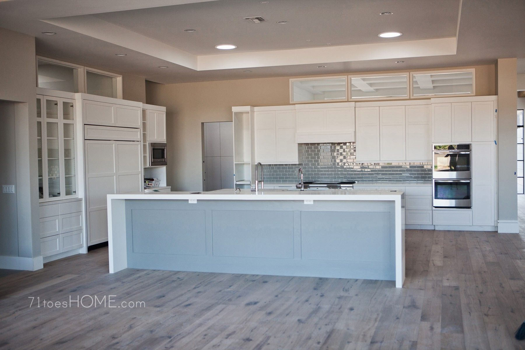 really like this clean design. grey/blue back splash and paint for ...