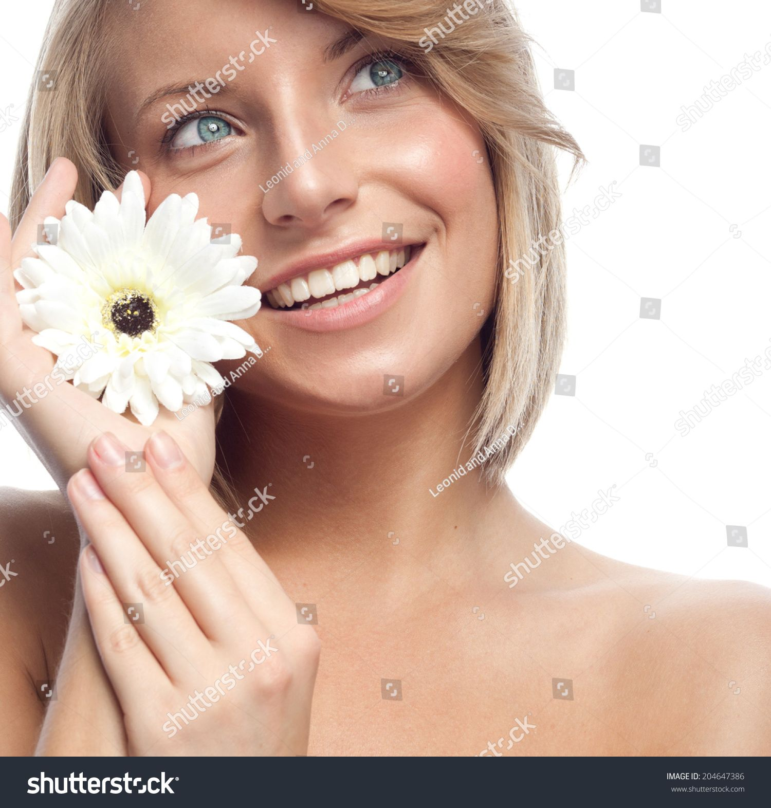 closeup portrait of attractive caucasian smiling woman blond isolated on white studio shot lips toothy smile face hair head and shoulders looking up blue eyes teeth flower #Sponsored , #AFFILIATE, #isolated#blond#white#shot