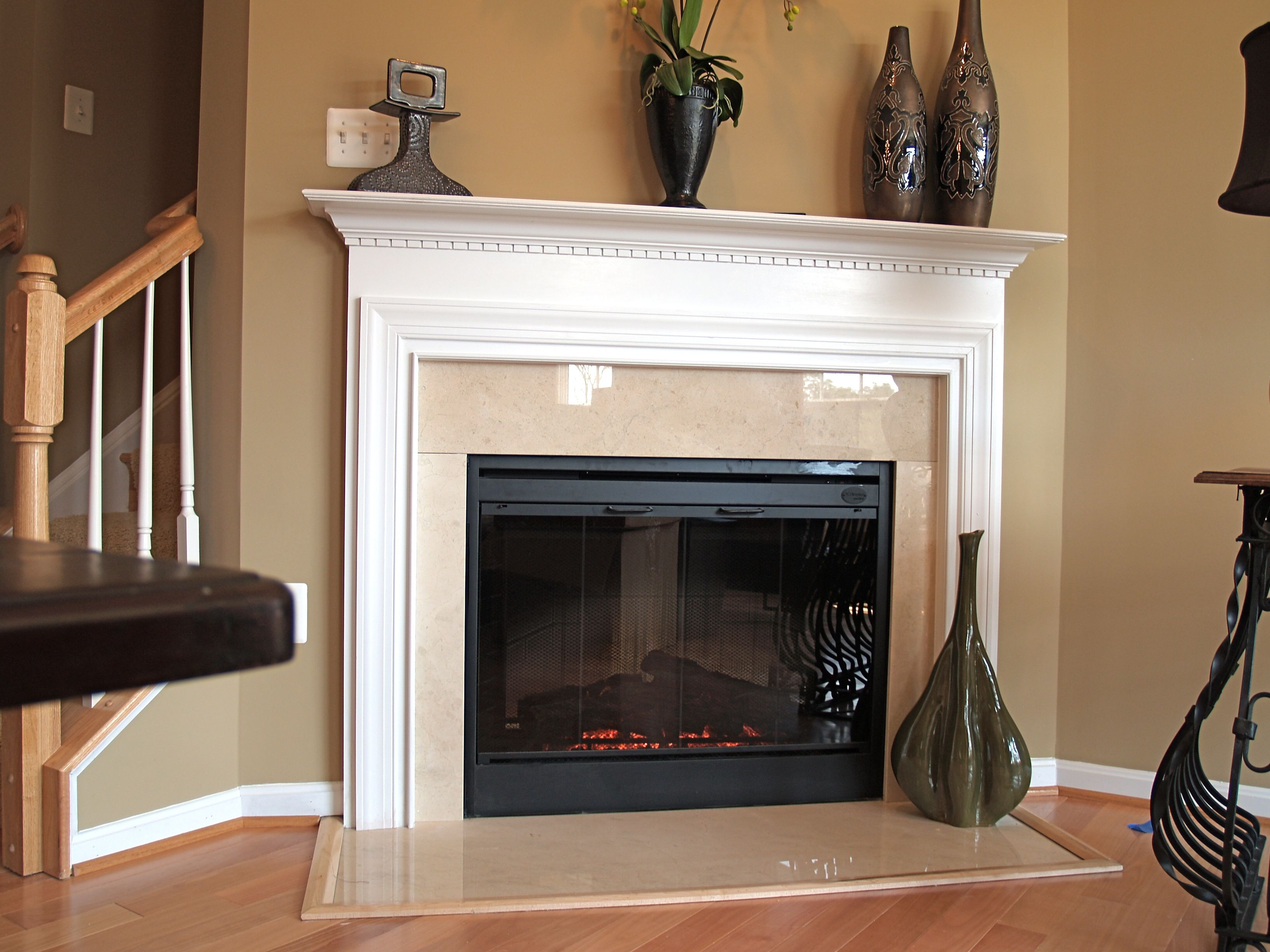 classic mantel shown with crema marfil marble and electric fireplace