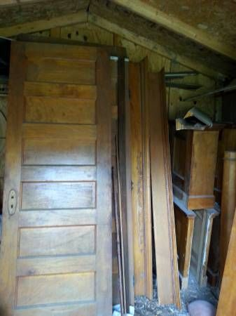 Five 7 Foot Tall Six Paneled Interior Doors Solid Wood Very Heavy 4 Columns With Stands Various Lengths Of Door Headers And Trim Work